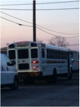 Buses with detainees leaving detention center for airport