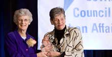 Ruth Rothstein (right) presents the Rabbi Robert J. J. Marx Social Justice award to Sister Sheila Lyne in 2008.