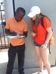 Or Tzedek participant, Emily Merrick, registering a new voter