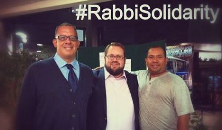 Rabbi Ben Greenberg, director of programs, with two workers from Golan's Moving and Storage