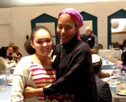 Stacey Flint and her daughter, Lauren, at the JCUA member Hanukkah party.