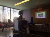 Emma Epstein, an Or Tzedek staff member, leads a workshop on the Trauma Center Campaign.