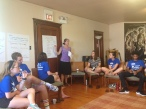 Jessica Havens teaches a workshop on identity and privilege at our home for the week, the Br. David Darst Center.