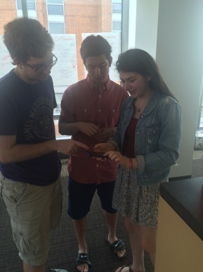 Alex, Sam, and Roz work together to share info about the Trauma Center Campaign prayer vigil on social media.