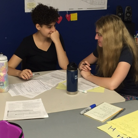 Dina and Sarah do some voter reg role play