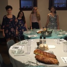 Dina, Sarah, Roz, and staff member Lili Gecker set the table for our first Shabbat