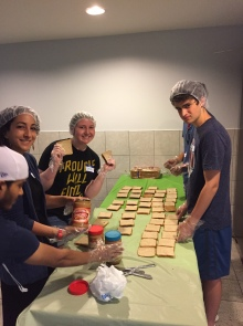 Leora and Gabe make lunches with Forward Humanity
